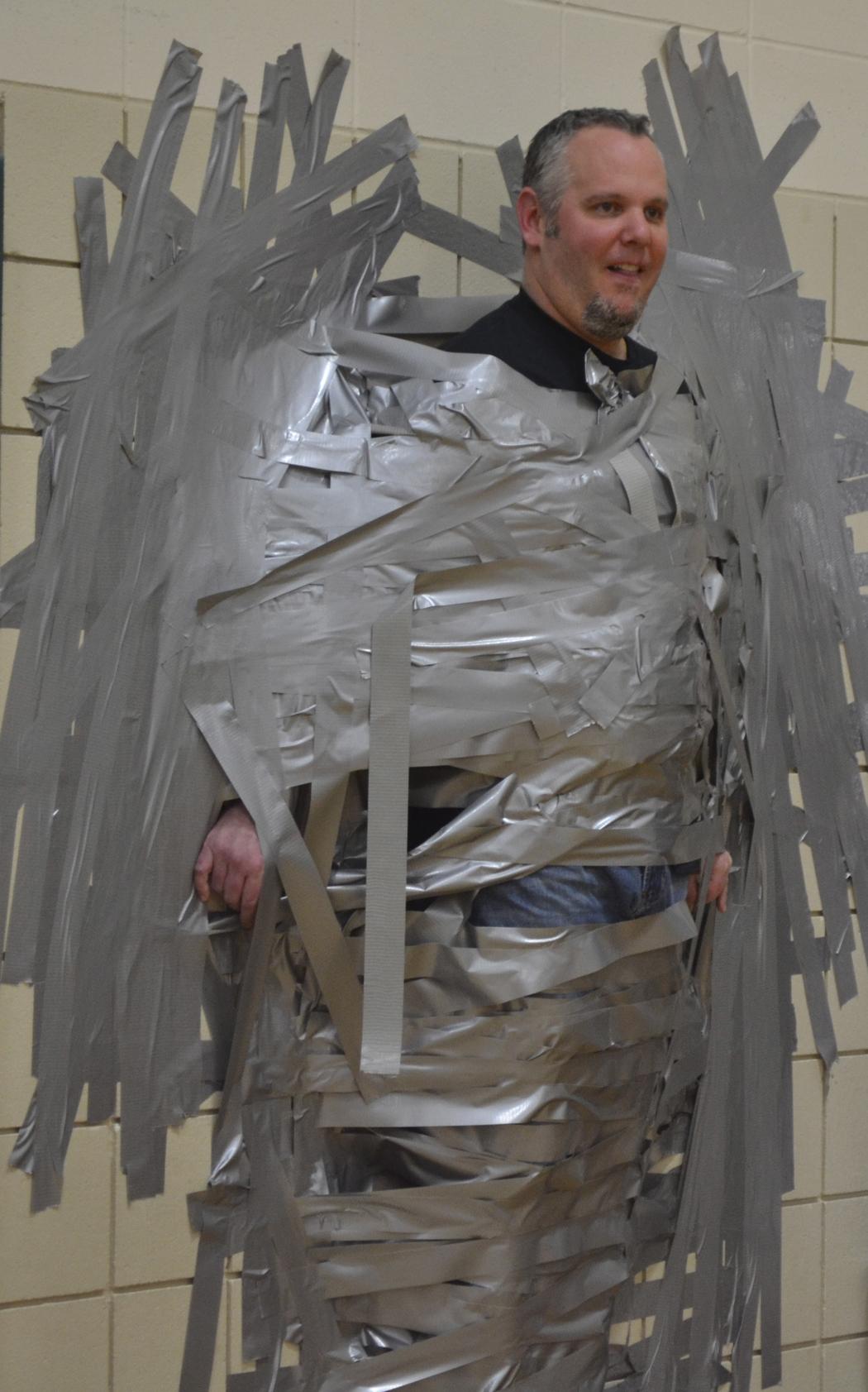 Mr Sawatzke taped to the wall.jpg